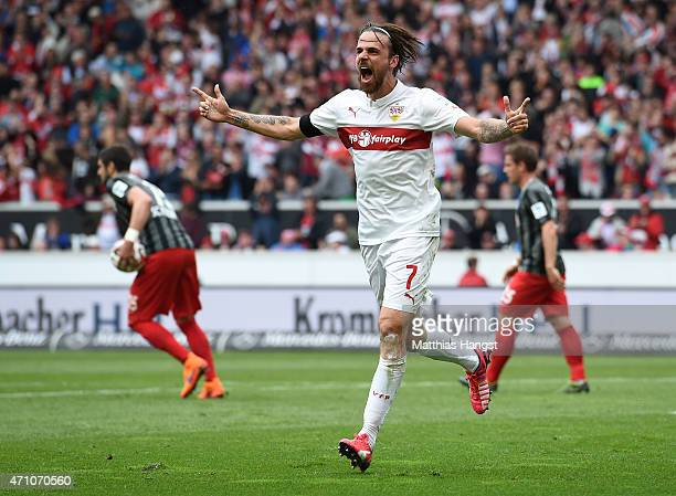 Martin Harnik of Stuttgart celebrates with his teammates after scoring his team's second goal during the Bundesliga match between VfB Stuttgart and...