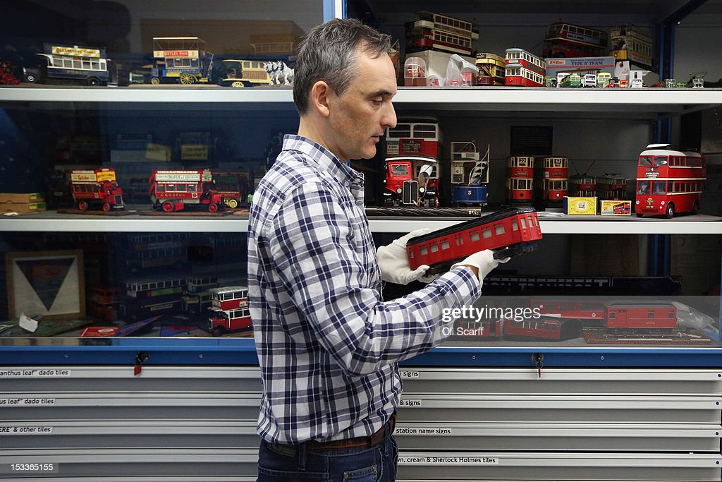 Martin Harrison-Putnam, Head of Collections at the London Transport Museum Depot in Acton, views a conserved model of a 1935 Underground train prior to the depot's open weekend on October 4, 2012 in London, England. The museum depot, which houses over 400,000 objects, will open its doors to the general public this weekend, October 6 and October 7, 2012. Artifacts throughout the ages include historic road and rail vehicles, thousands of posters and artworks, signage, engines, models, uniforms and ticket machines.