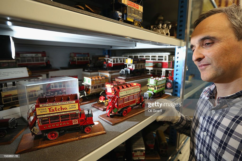 Martin Harrison-Putnam, Head of Collections at the London Transport Museum Depot in Acton, views a conserved models of London buses prior to the depot's open weekend on October 4, 2012 in London, England. The museum depot, which houses over 400,000 objects, will open its doors to the general public this weekend, October 6 and October 7, 2012. Artifacts throughout the ages include historic road and rail vehicles, thousands of posters and artworks, signage, engines, models, uniforms and ticket machines.