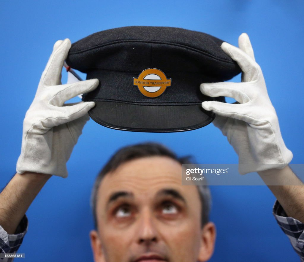 Martin Harrison-Putnam, Head of Collections at the London Transport Museum Depot in Acton, views a conserved London Underground workers hat from 1978 prior to the depot's open weekend on October 4, 2012 in London, England. The museum depot, which houses over 400,000 objects, will open its doors to the general public this weekend, October 6 and October 7, 2012. Artifacts throughout the ages include historic road and rail vehicles, thousands of posters and artworks, signage, engines, models, uniforms and ticket machines.