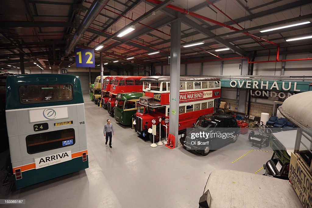 Martin Harrison-Putnam, Head of Collections at the London Transport Museum Depot in Acton, views conserved buses and taxis prior to the depot's open weekend on October 4, 2012 in London, England. The museum depot, which houses over 400,000 objects, will open its doors to the general public this weekend, October 6 and October 7, 2012. Artifacts throughout the ages include historic road and rail vehicles, thousands of posters and artworks, signage, engines, models, uniforms and ticket machines.