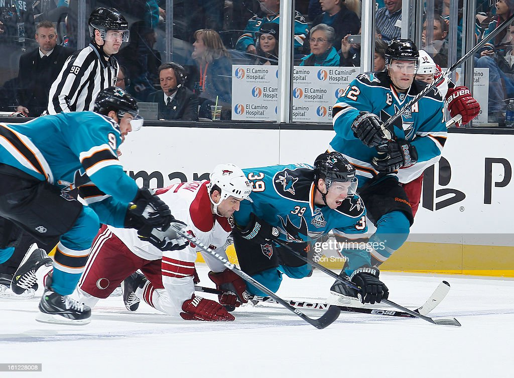 Martin Havlat #9, Logan Couture #39 and Patrick Marleau #12 of the San Jose Sharks fight for the puck against Boyd Gordon #15 of the Phoenix Coyotes during an NHL game on February 9, 2013 at HP Pavilion in San Jose, California.