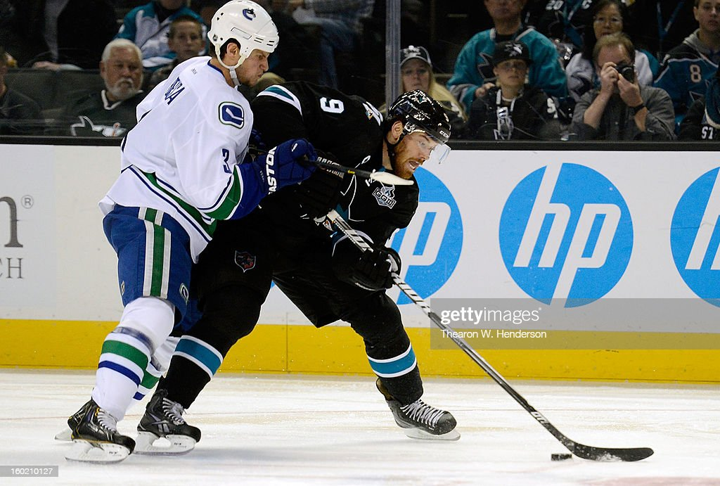 Martin Havlat #9 of the San Jose Shark controls the puck keeping it away from Kevin Bieksa #3 of the Vancouver Canucks in the second period of their game at HP Pavilion on January 27, 2013 in San Jose, California.