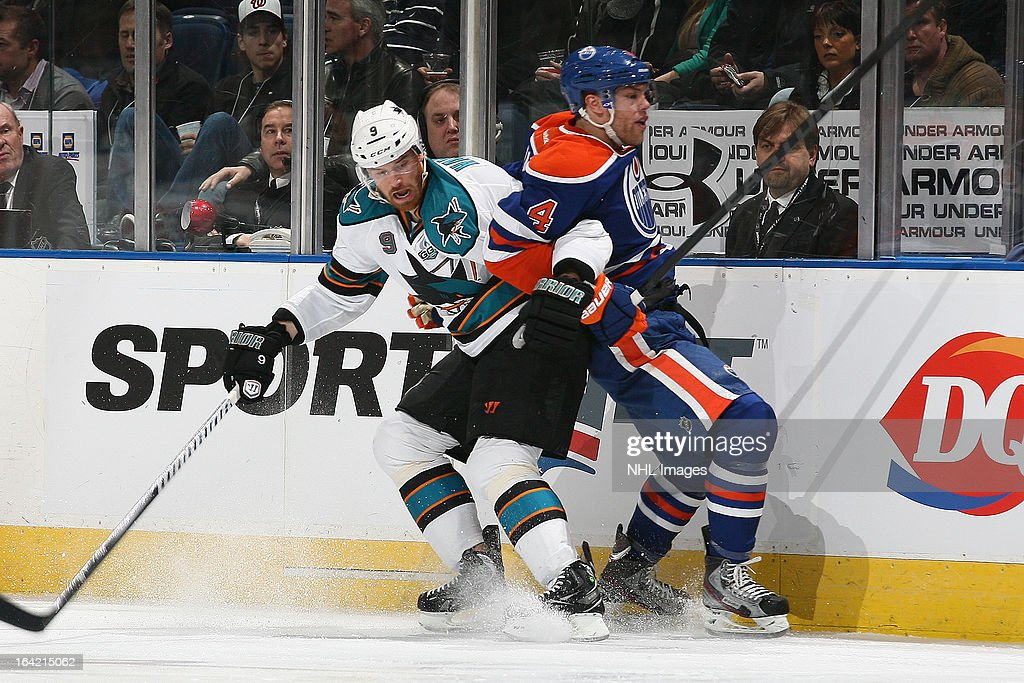 <a gi-track='captionPersonalityLinkClicked' href=/galleries/search?phrase=Martin+Havlat&family=editorial&specificpeople=202654 ng-click='$event.stopPropagation()'>Martin Havlat</a> #9 of the San Jose Sharks hits <a gi-track='captionPersonalityLinkClicked' href=/galleries/search?phrase=Taylor+Hall&family=editorial&specificpeople=2808377 ng-click='$event.stopPropagation()'>Taylor Hall</a> #4 of the Edmonton Oilers along the boards on March 20, 2013 at Rexall Place in Edmonton, Alberta, Canada.