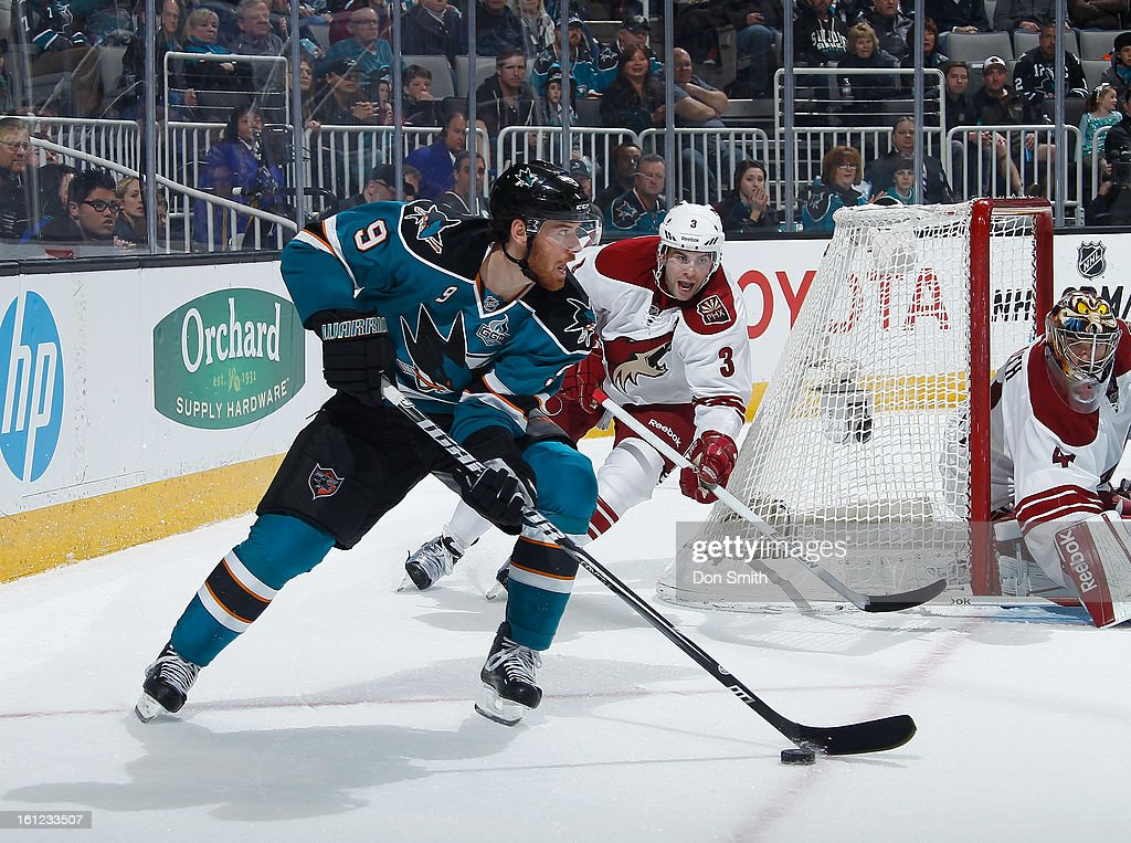 Martin Havlat #9 of the San Jose Sharks skates the puck around the net against Mike Smith #41 and Keith Yandle #3 of the Phoenix Coyotes during an NHL game on February 9, 2013 at HP Pavilion in San Jose, California.