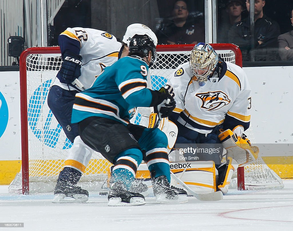 Martin Havlat #9 of the San Jose Sharks tries to score against Pekka Rinne #35 and Scott Hannan #22 of the Nashville Predators during an NHL game on February 2, 2013 at HP Pavilion in San Jose, California.