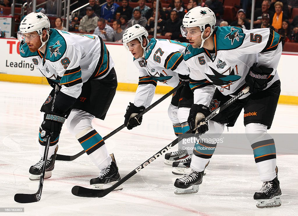 Martin Havlat #9, Tommy Wingels #57 and Jason Demers #5 of the San Jose Sharks take their position on the ice during the game against the Anaheim Ducks on February 4, 2013 at Honda Center in Anaheim, California.