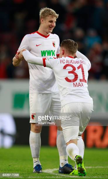 Martin Hinteregger and Philipp Max of Augsburg celebrate after the Bundesliga match between FC Augsburg and Werder Bremen at WWK Arena on February 5...