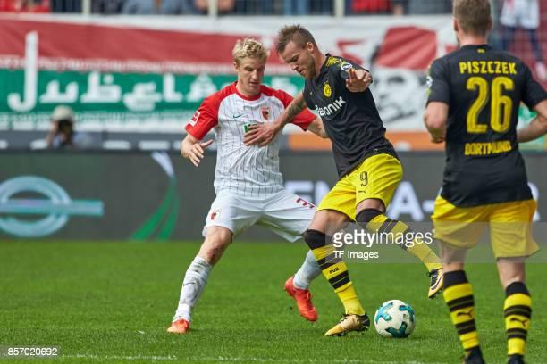 Martin Hinteregger of Augsburg and Andrey Yarmolenko of Dortmund battle for the ball during the Bundesliga match between FC Augsburg and Borussia...