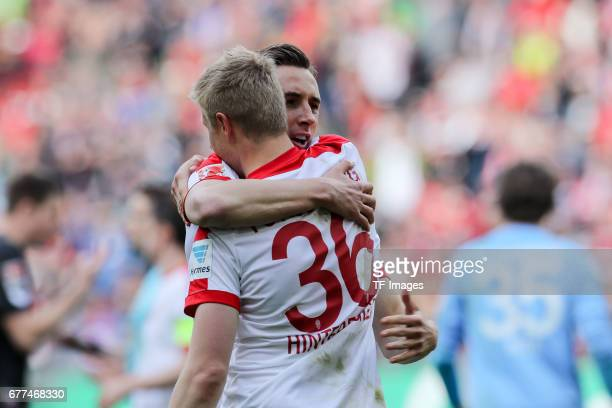 Martin Hinteregger of Augsburg and Dominik Kohr of Augsburg celebrates the win during the Bundesliga match between FC Augsburg and 1 FC Koeln at WWK...
