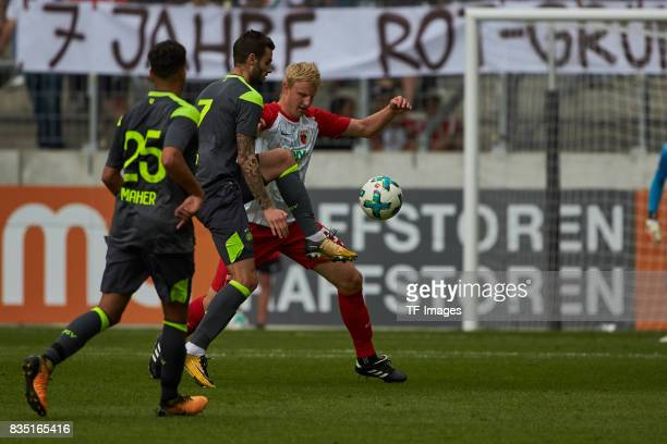 Martin Hinteregger of Augsburg and Gaston Pereiro of Eindhoven battle for the ball during the preseason friendly match between FC Augsburg and PSV...