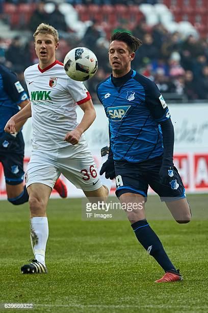 Martin Hinteregger of Augsburg and Mark Uth of 1899 Hoffenheim in action during the Bundesliga match between FC Augsburg and TSG 1899 Hoffenheim at...