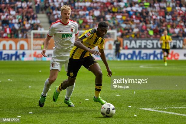 Martin Hinteregger of Augsburg and Ousmane Dembele of Dortmund battle for the ball during the Bundesliga match between FC Augsburg and Borussia...