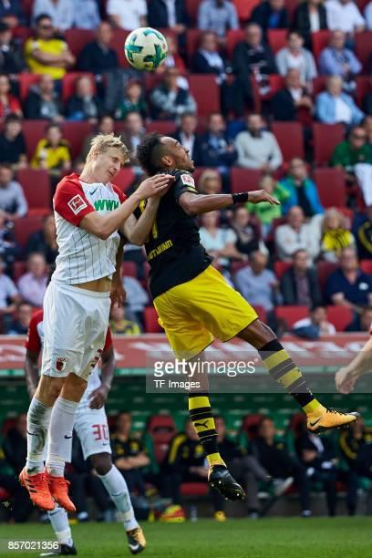 Martin Hinteregger of Augsburg and PierreEmerick Aubameyang of Dortmund battle for the ball during the Bundesliga match between FC Augsburg and...
