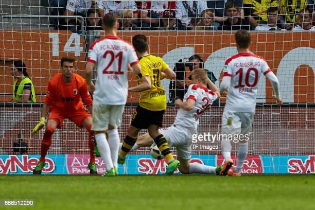 Martin Hinteregger of Augsburg and Raphael Guerreiro of Dortmund battle for the ball during the Bundesliga match between FC Augsburg and Borussia...