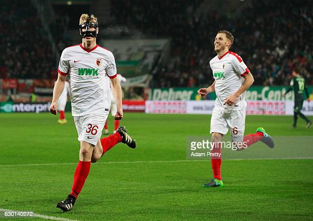 Martin Hinteregger of Augsburg celebrates with Jeffrey Gouweleeuw after scoring a goal during the Bundesliga match between FC Augsburg and Borussia...