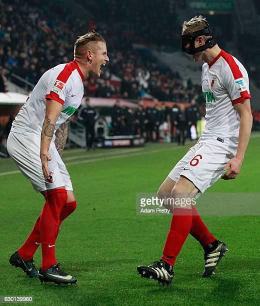 Martin Hinteregger of Augsburg celebrates with Jonathan Schmid after scoring a goal during the Bundesliga match between FC Augsburg and Borussia...
