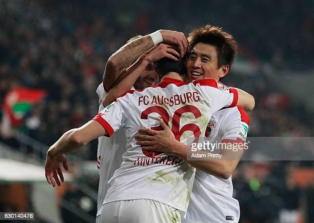 Martin Hinteregger of Augsburg celebrates with Koo JaCheol after scoring a goal during the Bundesliga match between FC Augsburg and Borussia...