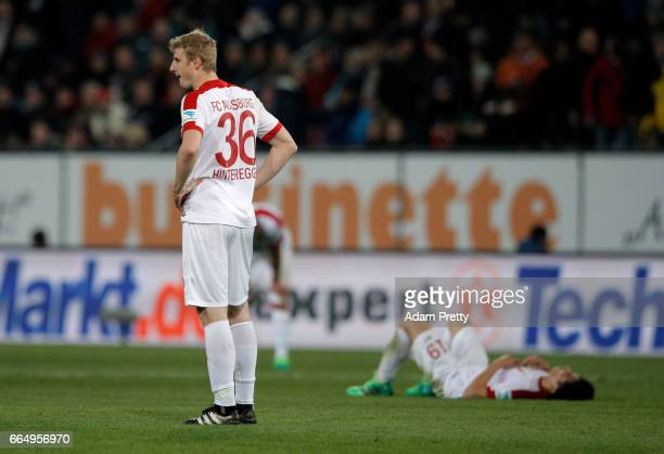 Martin Hinteregger of Augsburg looks dejected after he Bundesliga match between FC Augsburg and FC Ingolstadt 04 at WWK Arena on April 5 2017 in...
