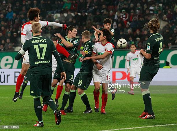 Martin Hinteregger of Augsburg scores a goal during the Bundesliga match between FC Augsburg and Borussia Moenchengladbach at WWK Arena on December...