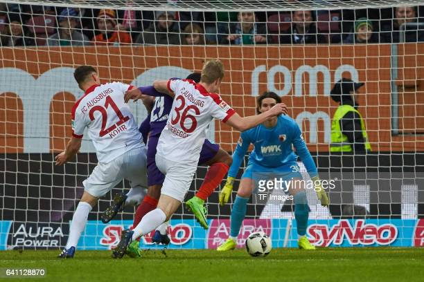 Martin Hinteregger of Augsburg Serge Gnabry of Bremen zu Fall and verursacht einen Elfmeter Links Dominik Kohr of Augsburg battle for the ball during...
