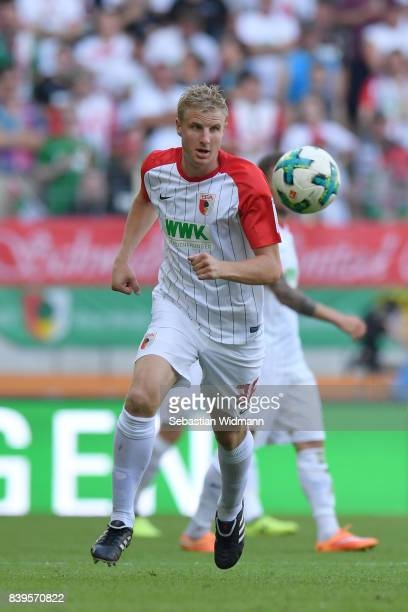 Martin Hinteregger of FC Augsburg plays the ball during the Bundesliga match between FC Augsburg and Borussia Moenchengladbach at WWKArena on August...