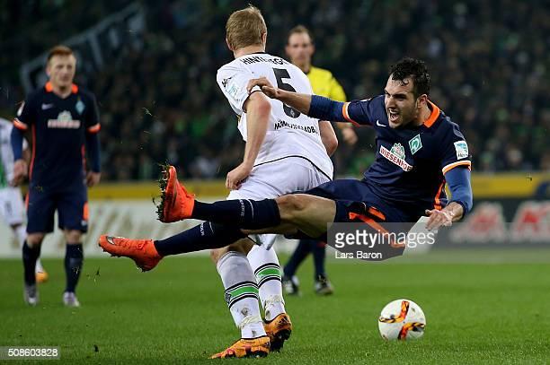 Martin Hinteregger of Moenchengladbach challenges Levin Mete Oeztunali of Bremen during the Bundesliga match between Borussia Moenchengladbach and...