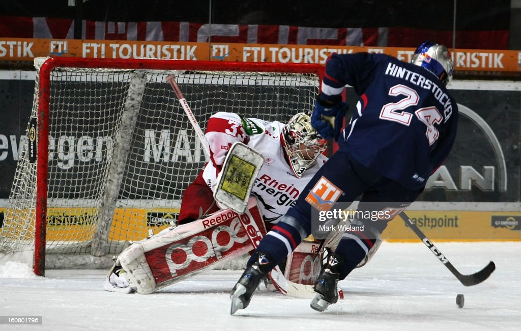 Martin Hinterstocker of EHC Muenchen takes a shot during the DEL match between EHC Muenchen and Koelner Haie at Olympia Eishalle on February 3, 2013 in Munich, Germany.