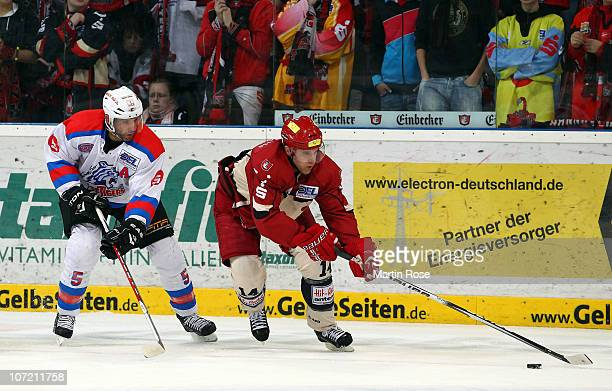 Martin Hlinka of Hannover and Robert Leask of Nuernberg battle for the puck during the DEL match between Hannover Scorpions and Thomas Sabo Ice...