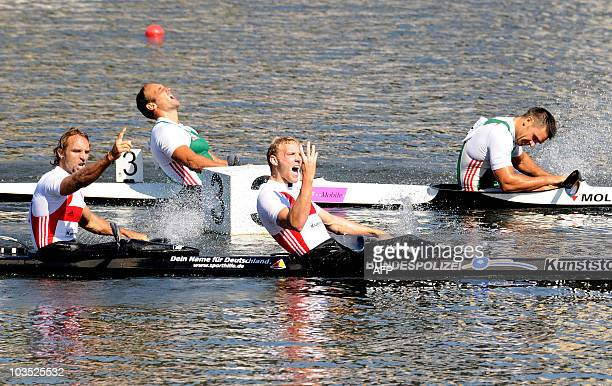 Martin Hollstein and Andreas Ihle of Germany celebrate their win ahead of Zoltan Kammerer and Akos Vereckei of Hungary whom finished second in the...