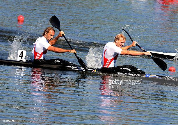 Martin Hollstein and Andreas Ihle of Germany race in the men's 1000 meters K2 final at the 2010 ICF Canoe Sprint World Championships in Poznan on...