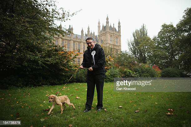 Martin Horwood Liberal Democrat MP for Cheltenham stands in front of The Houses of Parliament with his dog Kathleen during the Westminster Dog of The...