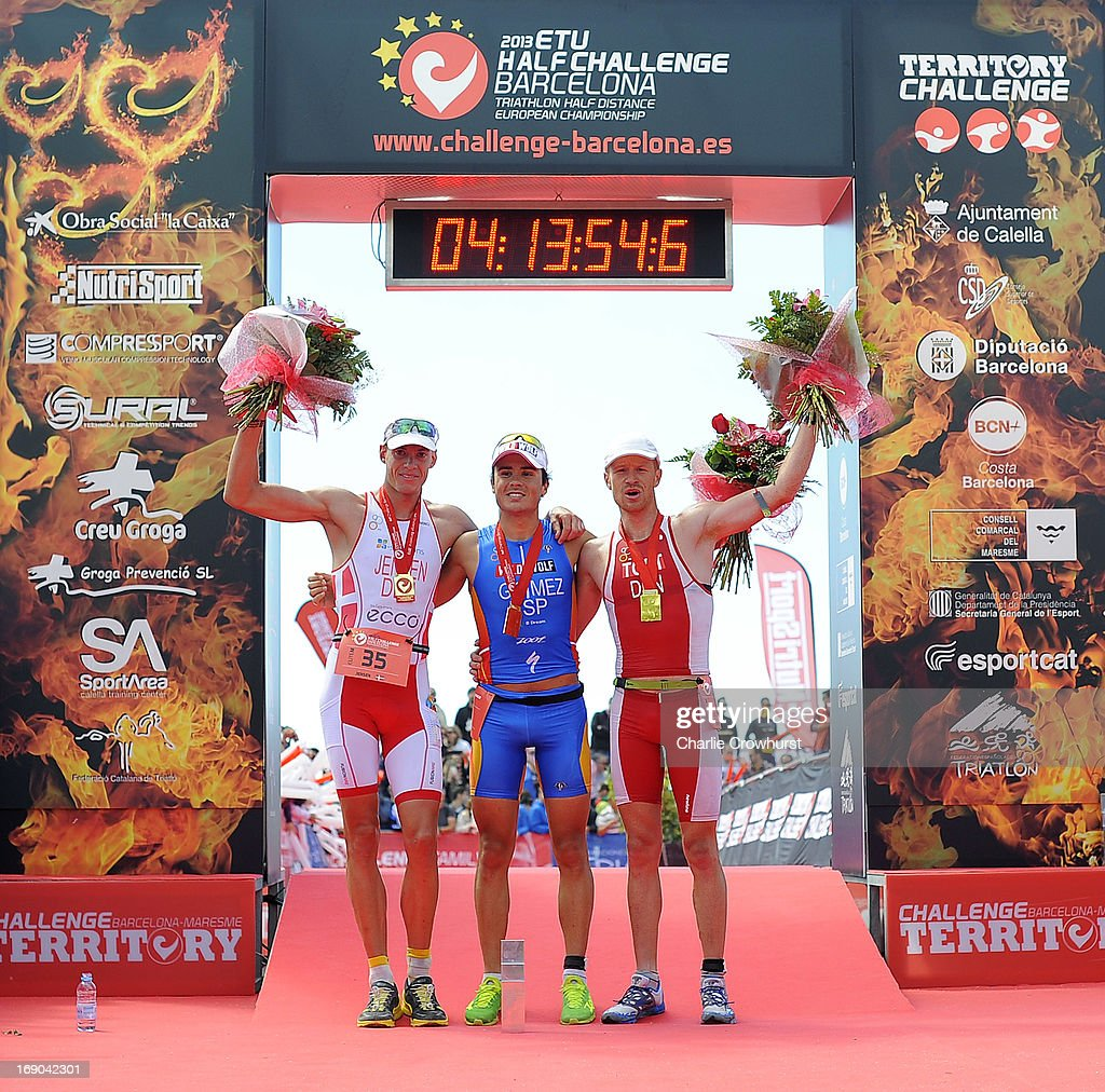 Martin Jensen of Denmark (L) Javier Gomez of Spain (R) and Jens Toft of Denmark (R) pose with their medals during the Challenge Family Triathlon Barcelona on May 19, 2013 in Barcelona, Spain.