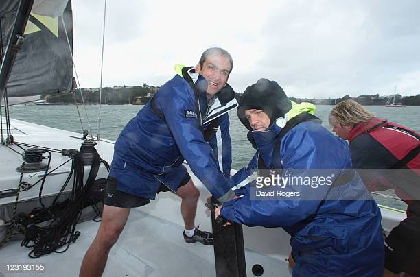 Martin Johnson and Lee Mears of England winch the sails as the England IRB Rugby World Cup 2011 squad enjoy a sailing day on exAmerica's Cup yachts...