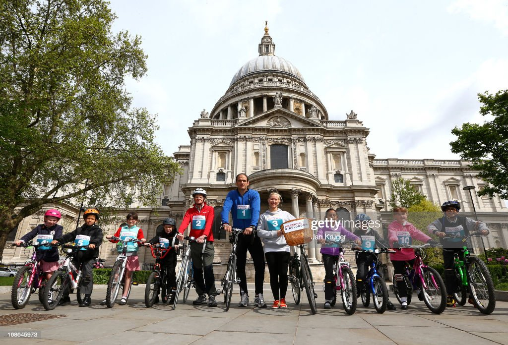 Martin Johnson (C) is joined by Tom Harrison (5L), Beth Nimmock (5R) and children from Field End Junior School at the Prudential RideLondon Freecycle launch at St Paul's on May 13, 2013 in London, England. The Prudential RideLondon Freecycle event takes place on August 3, 2013 where there will be an attempt to break the Guinness World Record for the longest single parade of bicycles