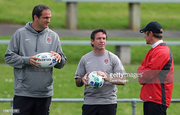 Martin Johnson manager of England talks with Mike Ford the England defence coach and Brian Smith the England attack coach during an England IRB Rugby...