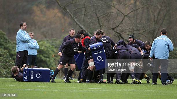 Martin Johnson the England head coach watches practice during the England training session held at Pennyhill Park on November 18 2009 in Bagshot...