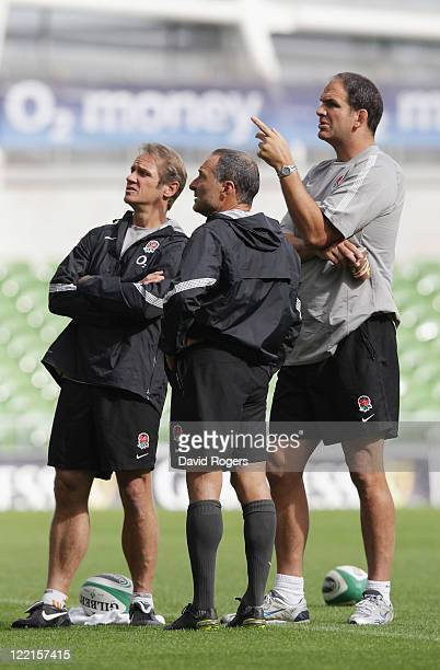 Martin Johnson the England manager looks on with assistant coaches Brian Smith and Dave Alred during the England captain's run held at the Aviva...