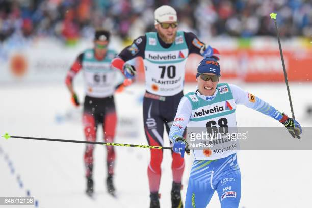 Martin Johnsrud Sundby from Norway on his finish just after Finland's Matti Heikkinen Men crosscountry 15km Individual Classic at FIS Nordic World...