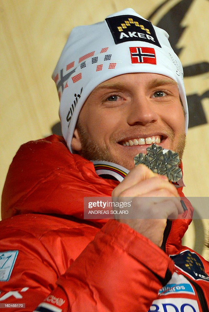 Martin Johnsrud Sundby of Norway poses on February 23, 2013 with his silver medal on the podium of the men's cross country 15 kms classic +15 km free Skiathlon race of the FIS Nordic World Ski Championships at the Val Di Fiemme Cross Country stadium in Cavalese, northern Italy.