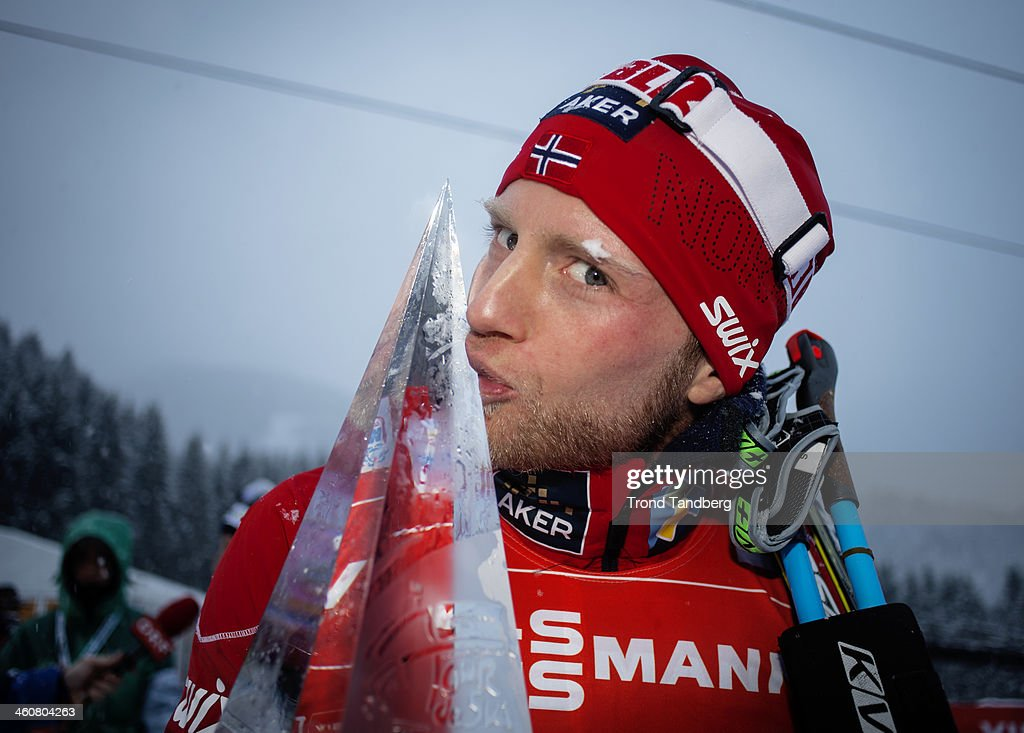<a gi-track='captionPersonalityLinkClicked' href=/galleries/search?phrase=Martin+Johnsrud+Sundby&family=editorial&specificpeople=4668146 ng-click='$event.stopPropagation()'>Martin Johnsrud Sundby</a> of Norway poses with the trophy after taking 1st place during the FIS Cross-Country World Cup Tour de Ski Men's 9 km F Final Climb Pursuit on January 5, 2014 at Val Di Fiemme, Italy.