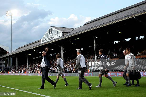 Martin Jol manager of Fulham waves to the crowd ahead of the UEFA Europa League qualifying match between Fulham and NSI Runavik at Craven Cottage on...