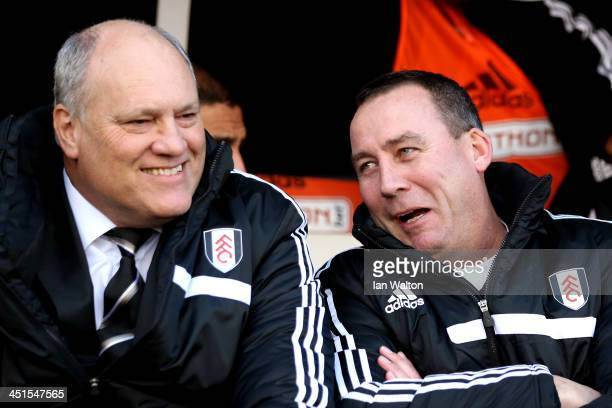 Martin Jol the Fulham manager chats with Rene Meulensteen the Fulham head coach prior to kickoff during the Barclays Premier League match between...