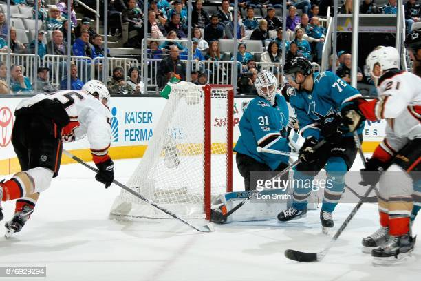 Martin Jones and Tim Heed of the San Jose Sharks protect the net against Sami Vatanen of the Anaheim Ducks at SAP Center on November 20 2017 in San...