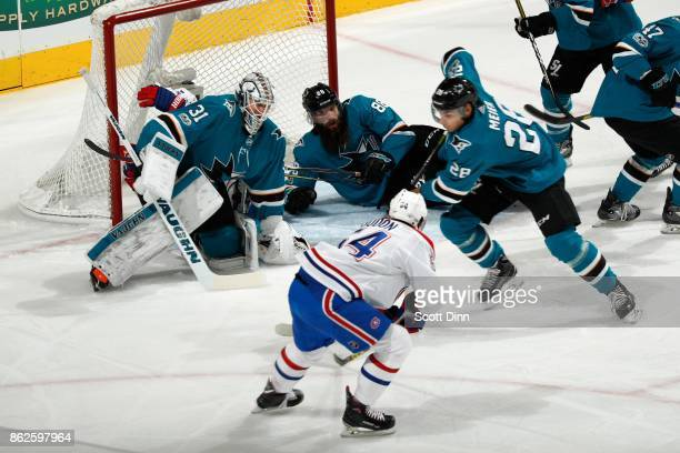Martin Jones Brent Burns and Timo Meier of the San Jose Sharks defend against Charles Hudon of the Montreal Canadiens at SAP Center on October 17...