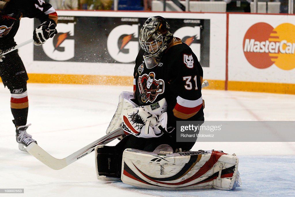 Martin Jones #31 of the Calgary Hitmen stops the puck during the game against the Brandon Wheat Kings at the 2010 Mastercard Memorial Cup Tournament at the Keystone Centre on May 19, 2010 in Brandon, Manitoba, Canada. The Hitmen defeated the Wheat Kings 5-1.