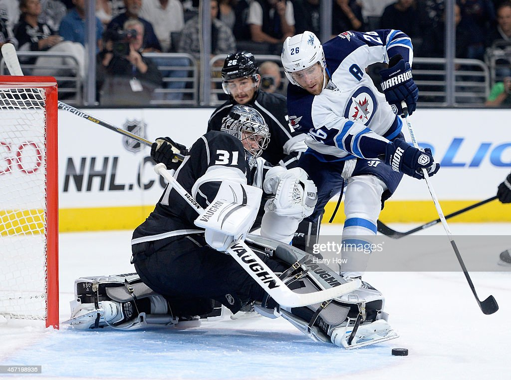 Martin Jones #31 of the Los Angeles Kings makes a save on Blake Wheeler #26 of the Winnipeg Jets during the first period at Staples Center on October 12, 2014 in Los Angeles, California.