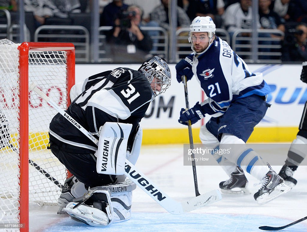 Martin Jones #31 of the Los Angeles Kings makes a save on T.J. Galiardi #21 of the Winnipeg Jets during a 4-1 Kings win at Staples Center on October 12, 2014 in Los Angeles, California.