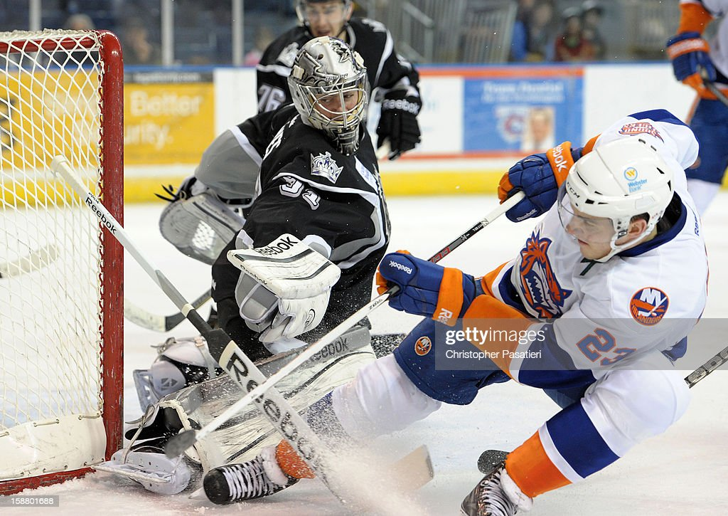 Martin Jones #31 of the Manchester Monarchs stops a shot on goal by John Persson #23 of the Bridgeport Sound Tigers during an American Hockey League game on December 29, 2012 at the Webster Bank Arena at Harbor Yard in Bridgeport, Connecticut.