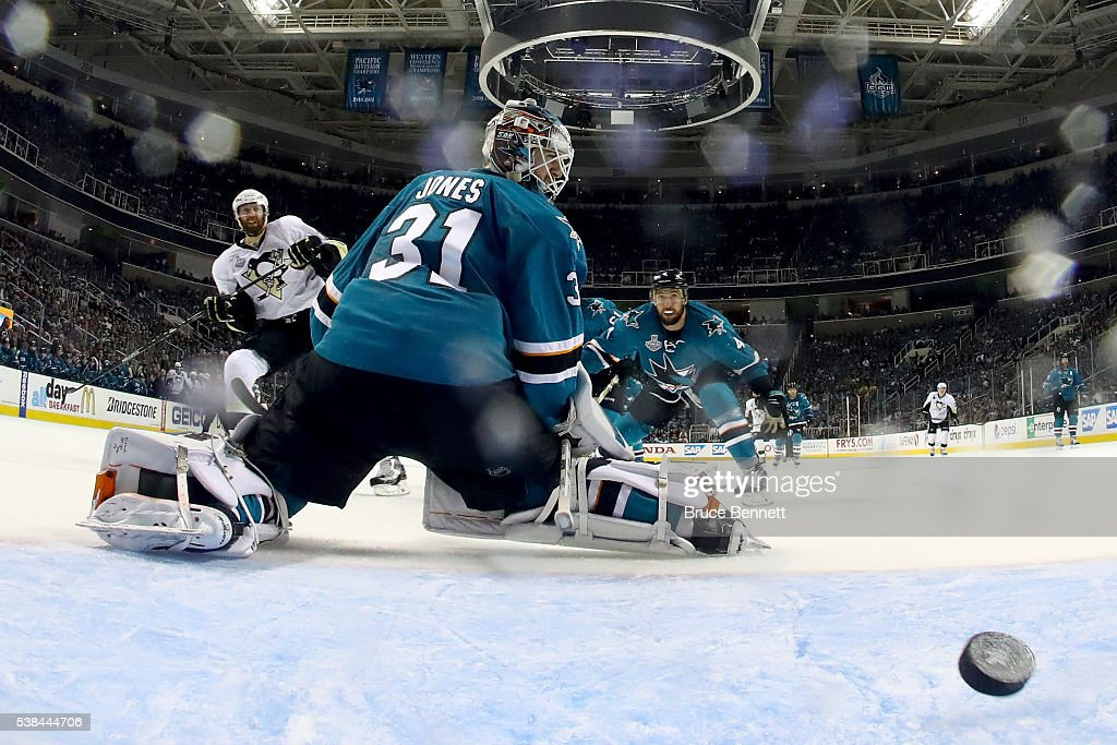 Martin Jones #31 of the San Jose Sharks allows a goal to Eric Fehr #16 of the Pittsburgh Penguins in the third period of Game Four of the 2016 NHL Stanley Cup Final at SAP Center on June 6, 2016 in San Jose, California.